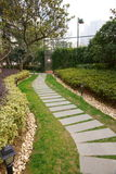Path to the tennis court in Vertical composition. This path in a park.It's a very beautiful view Stock Photo