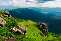 Path to a tiger face cliff above the valley. Spectacular landscape of Carpathian mountains in summertime. location Pikui mountain, Ukraine royalty free stock photos