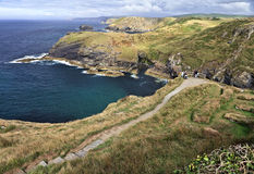 Path to Tintagel Castle Cornwall England medieval fortification on the peninsula of Tintagel Island. Royalty Free Stock Photography