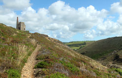 Path to Tywarnhayle tin mine engine house Cornwall Stock Photo