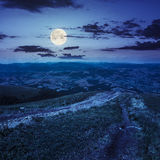 Path to village in mountain valley at night Stock Images