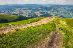 Path to village in mountain valley Royalty Free Stock Image