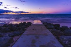 Path to the water at sunset royalty free stock photo