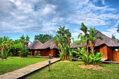 Path To Wooden African Chalets Stock Photos