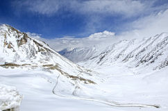Path towards dream. A road between the snow peaked mountains crossing rakhdungla pass Royalty Free Stock Photos