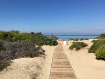 Pathway to beach. Path towards punta della suina beach Gallipoli Stock Photography