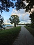 Path, trees and beautiful cloudy sky, Lithuania. Path, trees and beautiful cloudy sky in Rusne island near river , Lithuania stock image