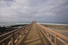 The path in the tropical pier. Some bungalow at the end of a pier in a resort Stock Image
