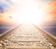 The path of the truth of Christ Jesus. The ancient railway leads to the colorful sky background Royalty Free Stock Images
