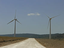 Path between turbines. Royalty Free Stock Photography
