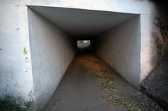 Path under the bridge. Narrow passage under the bridge royalty free stock photography