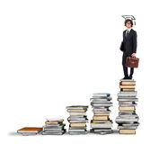 Path of undergraduate studies. Scale with books and man with graduation hat Stock Images