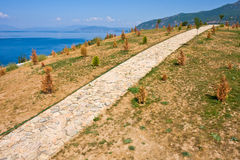 Path through a Unique Landscape. Paved path near Gradiste at Lake Ohrid, Macedonia Stock Image