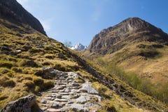 Path up Glencoe mountains Scotland UK in sunshine Royalty Free Stock Photography