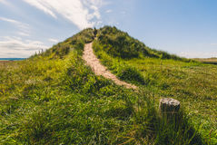 Path up grassy mound Royalty Free Stock Image
