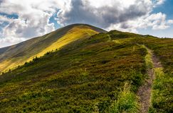 Path uphill the mountain ridge. Beautiful scenery in fine summer weather Royalty Free Stock Photos