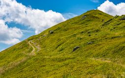 Path uphill to the peak of mountain ridge. Gorgeous summer nature scenery with cloudy sky. beautiful tourism background Royalty Free Stock Photos