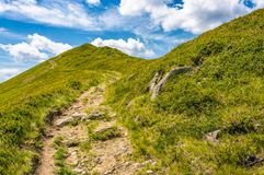 Path uphill to the peak of mountain ridge. Gorgeous summer nature scenery with cloudy sky. beautiful tourism background Stock Photography