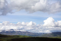 Path with Utah Snow capped mountains with rolling green hills Royalty Free Stock Photography