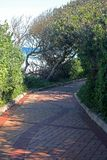 PATH AND VEGETATION NEXT TO THE SEA Stock Image