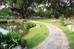Path walk curve side pond Royalty Free Stock Photos