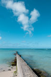 path walk way wall extend to clean blue sea on nice blue cloud sky vacation day. Royalty Free Stock Photos