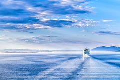 Path on the water from a large cruise ship Royalty Free Stock Photo