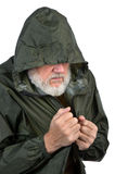 Pathetic senior man. In green waterproof jacket, may be homeless and jobless Royalty Free Stock Image