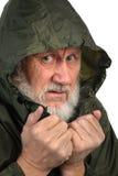 Pathetic senior man. In green waterproof hoody Royalty Free Stock Image