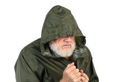 Pathetic senior man. In green waterproof jacket Royalty Free Stock Images