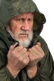 Pathetic senior man. In green waterproof jacket Royalty Free Stock Image