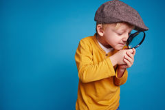Pathfinder. Inquisitive boy with magnifying glass Royalty Free Stock Photography