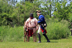 Pathfinder and Soldier. At reenactment of the conflict of Revolutionary War between refugees and Loyalists at  Black Creek -  in June 15 2013 in Black Creek Royalty Free Stock Photos