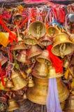 Pathivara Devi Temple. Photo of many golden bells with red cloth near Pathivara Devi Temple in Nepal Stock Photos