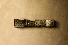 PATHOLOGIE - close-up van grungy wijnoogst gezet woord op metaalachtergrond royalty-vrije illustratie