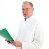 Pathologist in labcoat discussing results. Middle-aged pathologist in labcoat holding a green patient folder and discussing his results facing the camera Royalty Free Stock Photography