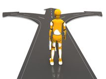 Paths. Crash test dummie thinkin in what road should he take Royalty Free Stock Image