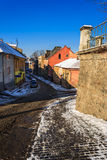 Paths diverge in old town winter. Paths diverge early winter morning in the old town Royalty Free Stock Image
