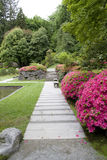 Paths and flowers in Japanese garden Stock Images