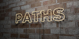 PATHS - Glowing Neon Sign on stonework wall - 3D rendered royalty free stock illustration. Can be used for online banner ads and direct mailers Royalty Free Stock Photo