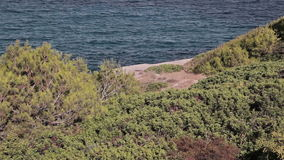 Paths and stairs along the slopes of the rocks along the beach. Spanish beaches in Cala Mendia. Mallorca