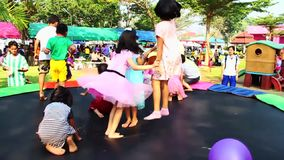 Pathum Thani, Thailand, -January, 12,2019: Group of children are playing trampoline fun in the sun. during kid day in thailand. stock video footage