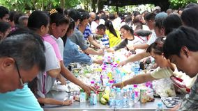 PATHUM THANI, THAILAND - JULY 12: People eat food offerings in the morning for Lent Day At Wat Na Pa Pong After Monk has finished Royalty Free Stock Image