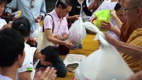 PATHUM THANI, THAILAND - JULY 12: People give food offerings in the morning for Lent Day At Wat Na Pa Pong. on July 12, 2014 Pathu Royalty Free Stock Image