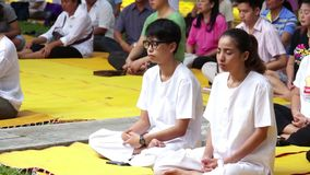 PATHUM THANI, THAILAND - JULY 12: People have a meditation in the morning for Lent Day At Wat Na Pa Pong. on July 12, 2014 Pathum Stock Photo