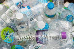 Pathumthani, Thailand - 2014: Clear plastic bottles lie in a bin Royalty Free Stock Image
