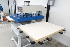 Pathumthani, Thailand - Feb 27, 2017 : Large heat press machine for fabric business in printing factory at Lumlukka, pathumthani stock photo