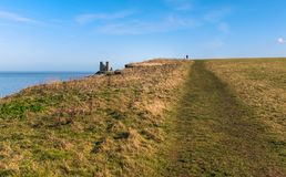 Reculver, Kent, UK along the cliff top walk on the coast near to. Pathway along the grass covered coastal clifftops of Reuclver country park near to Reculver Royalty Free Stock Images