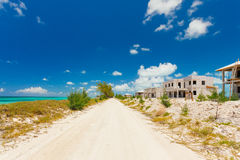 Pathway along the seaside and abandoned houses Stock Images