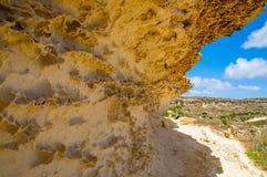Pathway along seaside cliffsnear at Gozo island in Malta. Stock Photo